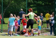 Coach Jane McIlwrath and budding players, Open day 2014